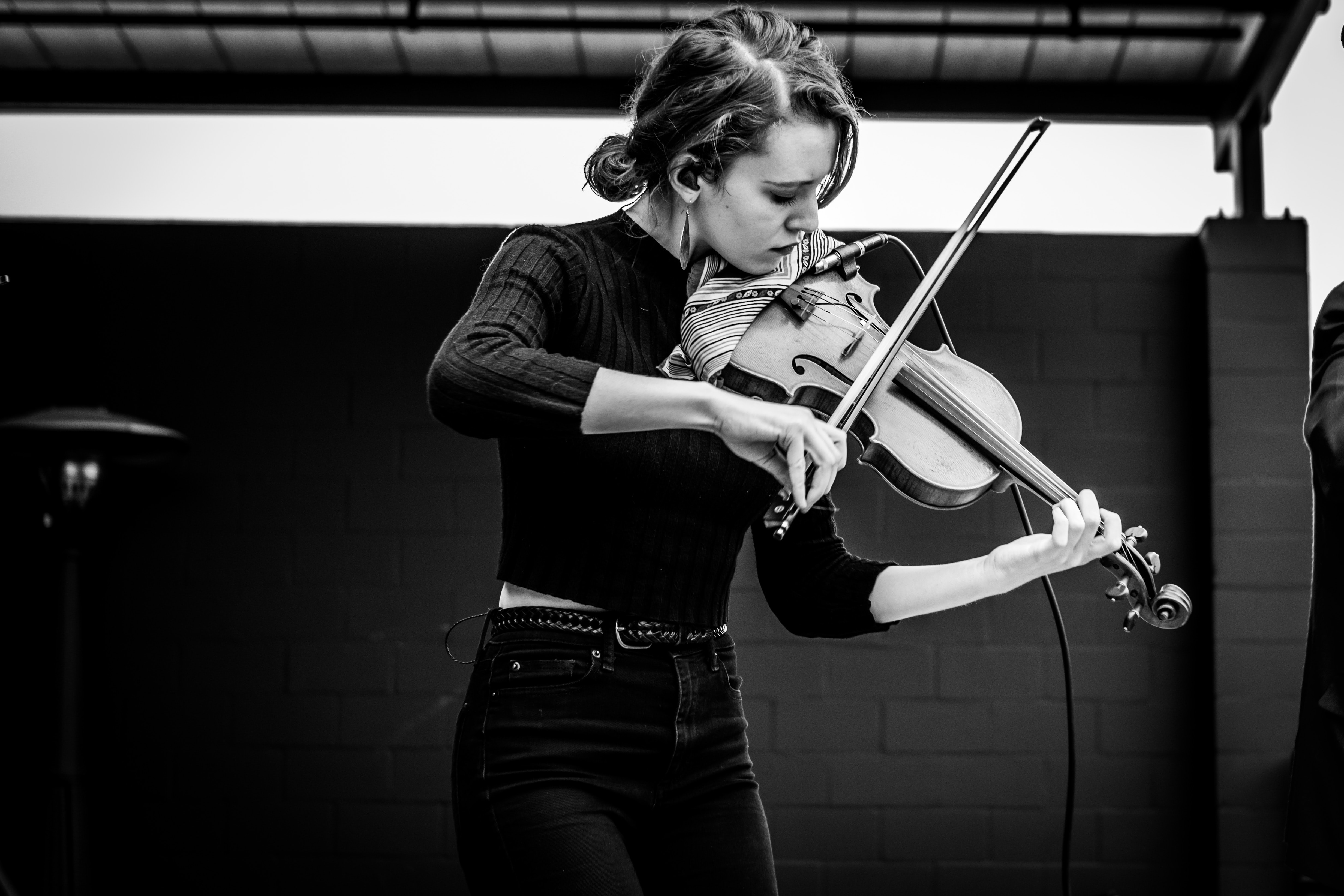grayscale photo of woman playing violin
