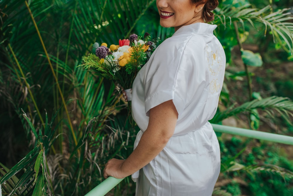 smiling woman holding flowers bouquet