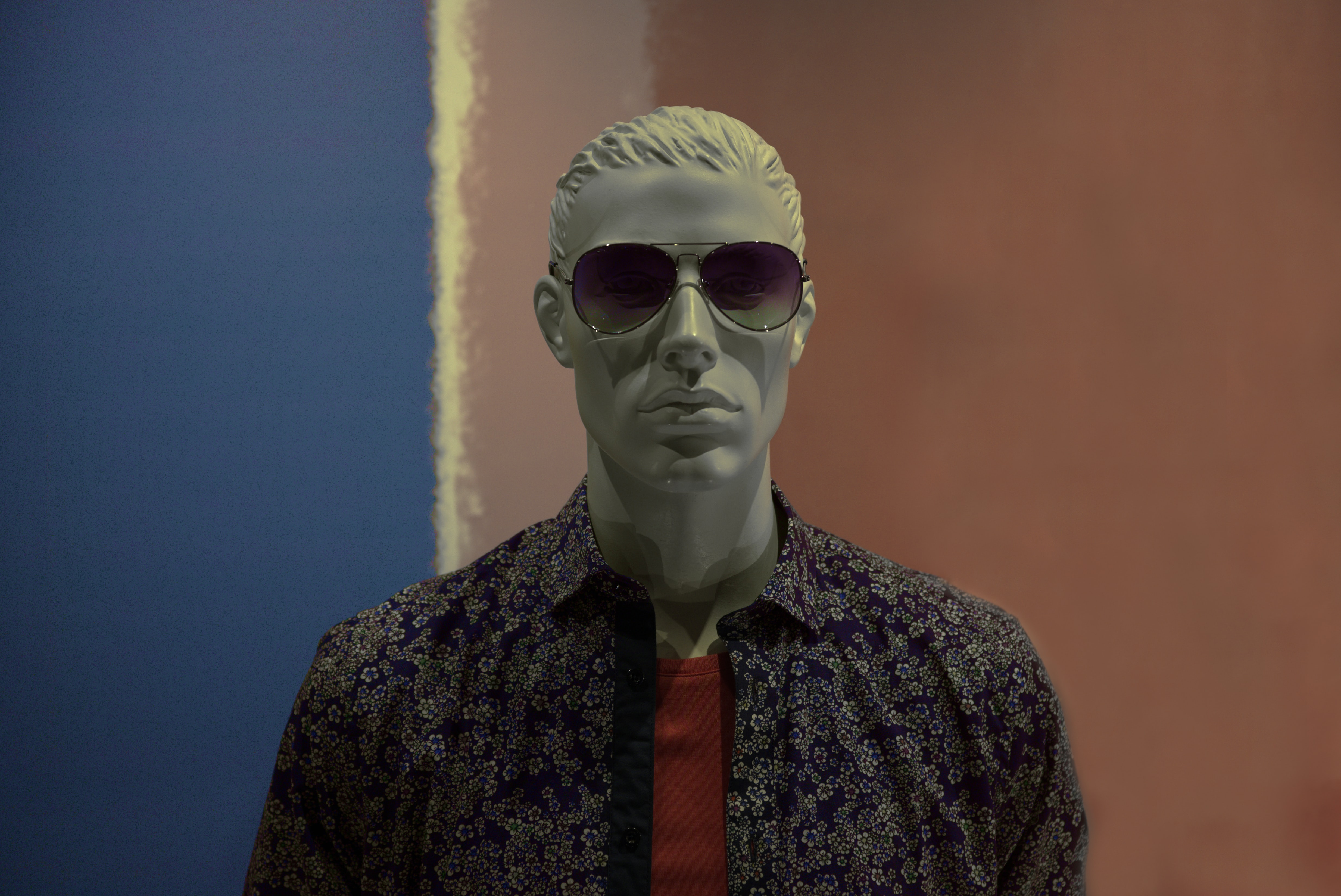 mannequin wearing purple sunglasses