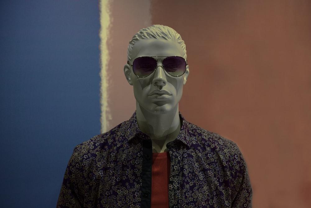 mannequin wearing purple sunglasses