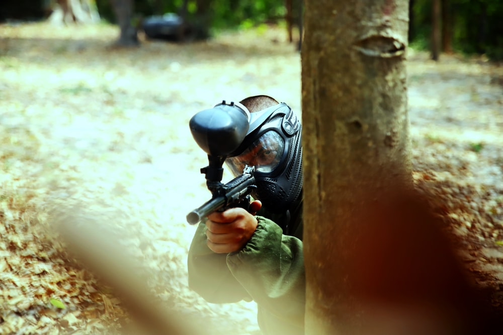 person holding paintball gun