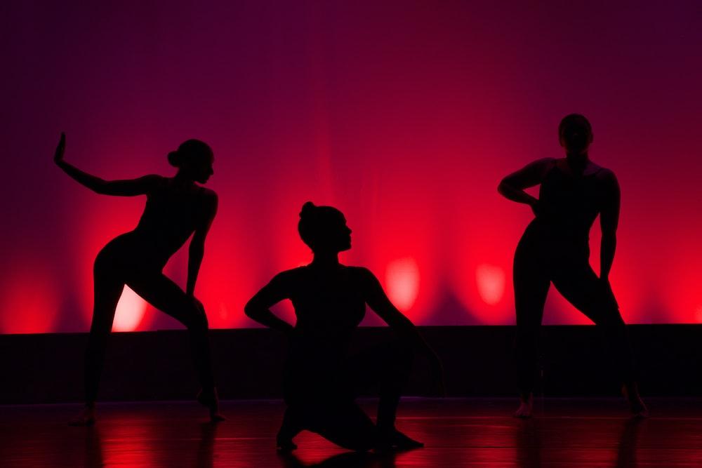 silhouette of people dancing