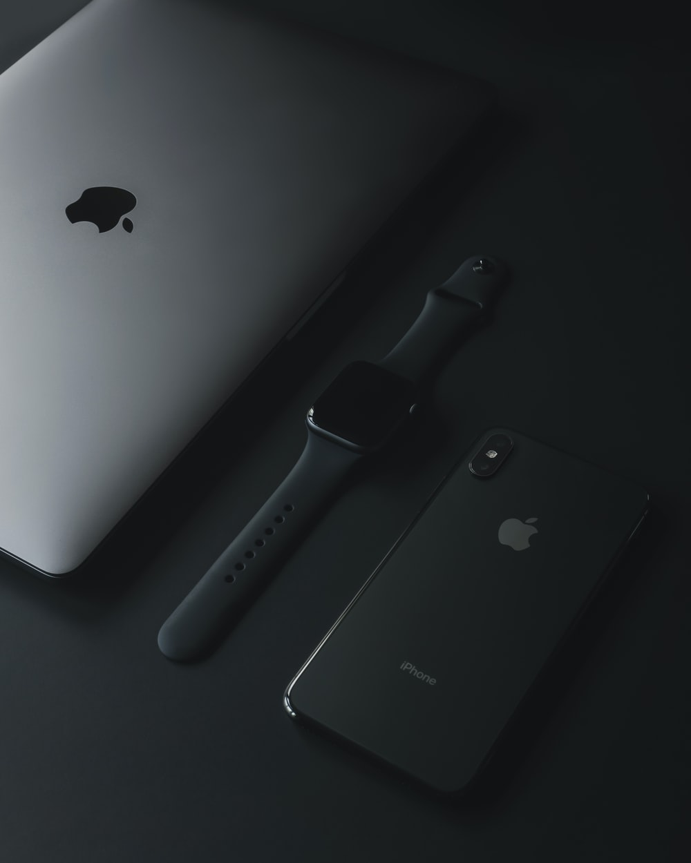 three assorted Apple products