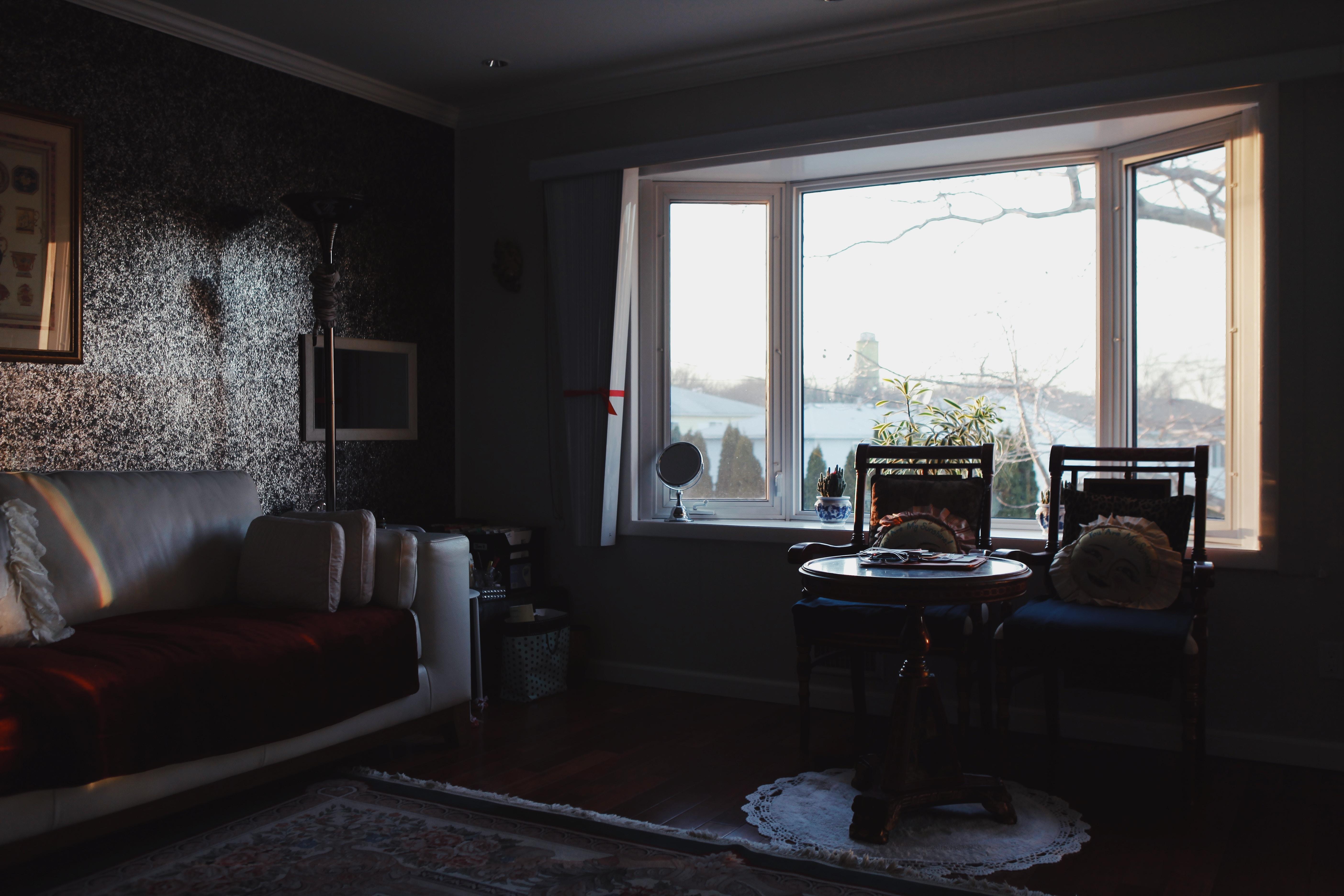 two chairs beside window