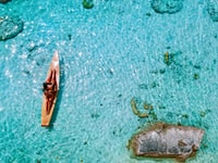 aerial photo of person riding boat during daytime