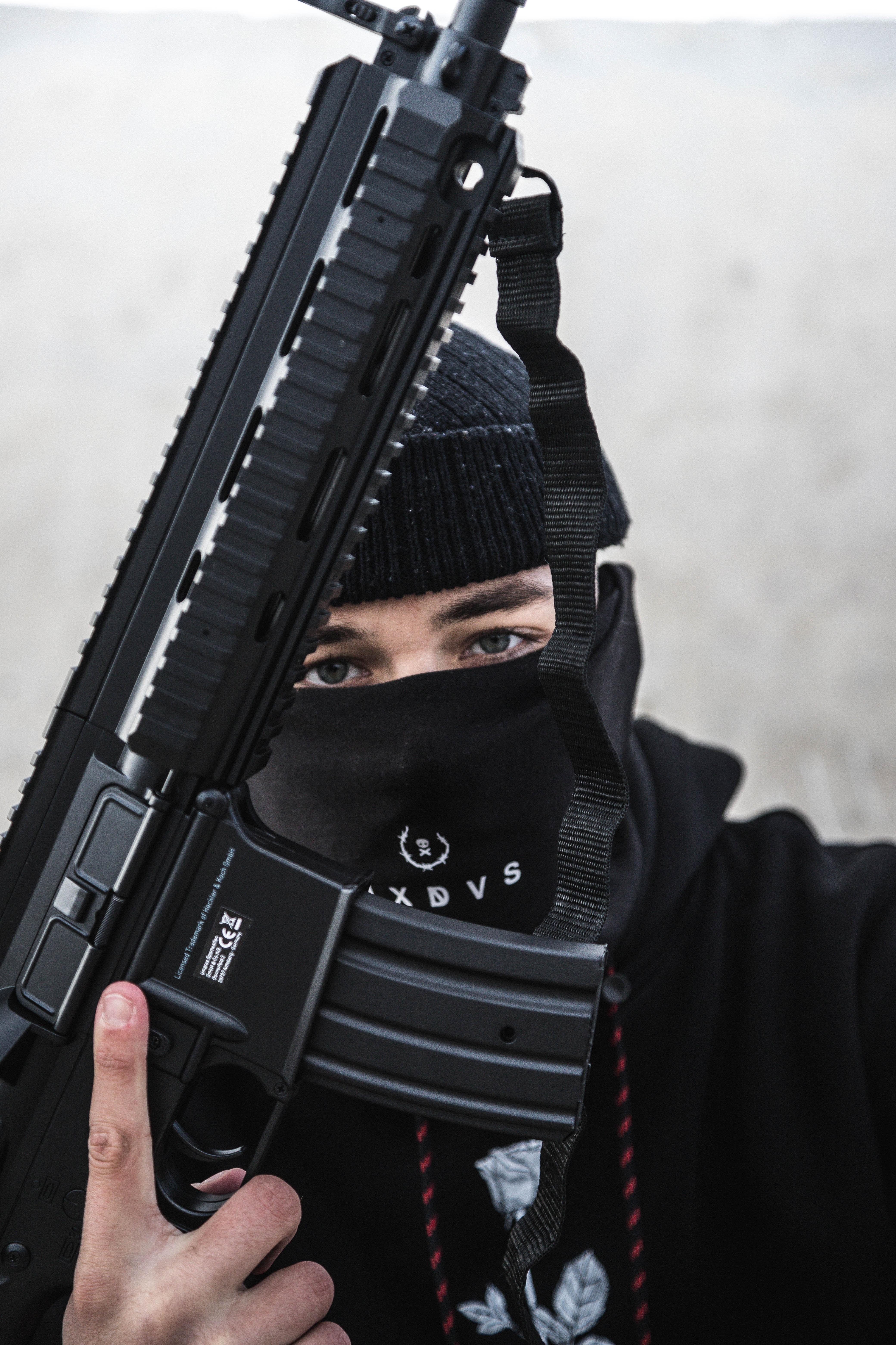 man holding A4 rifle