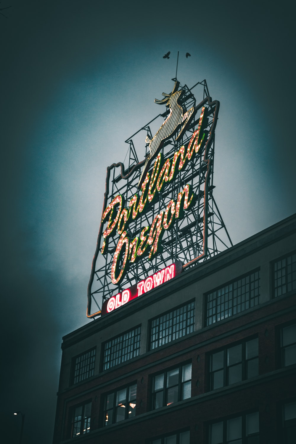 low-angle photography of Portland Oregon Old Town signage