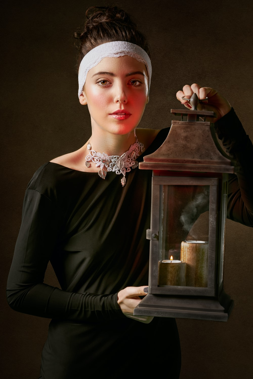 woman holding lantern lamp painting