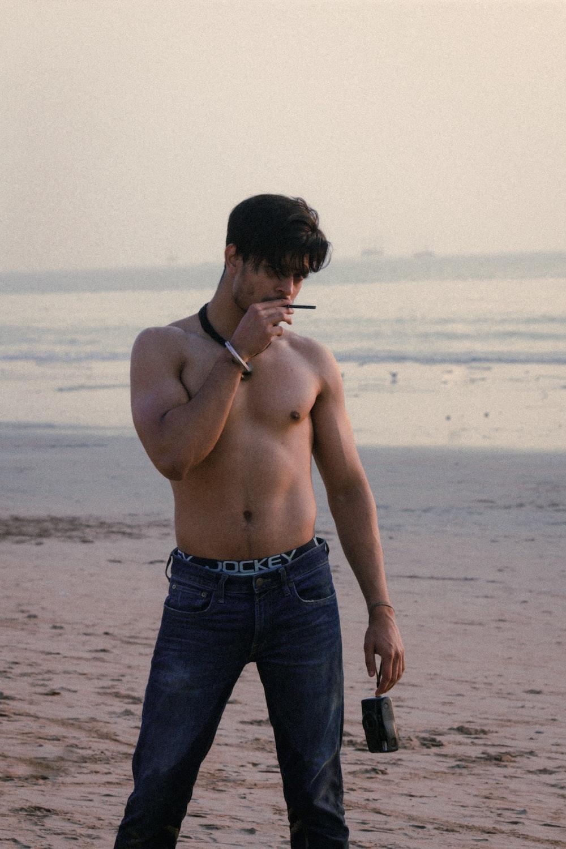 topless man smoking near bach
