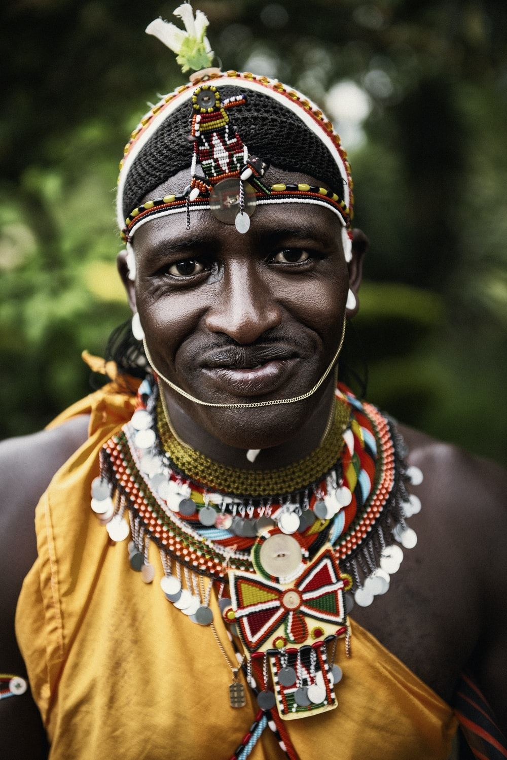 selective focus photography smiling man wearing multicolored costume