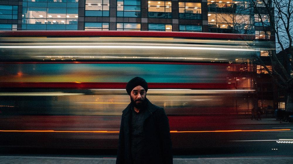 man wearing black jacket time-lapse photography