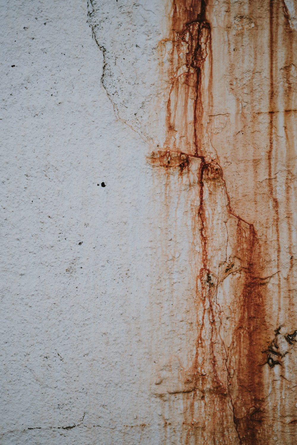 rust coming from white concrete