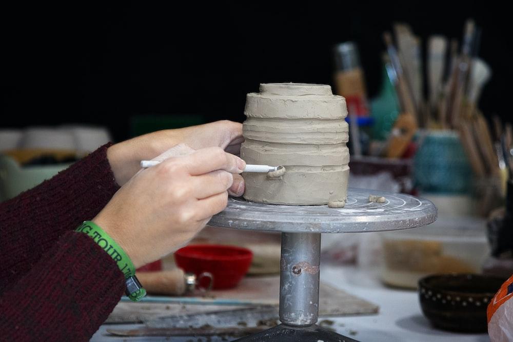 person carving pot
