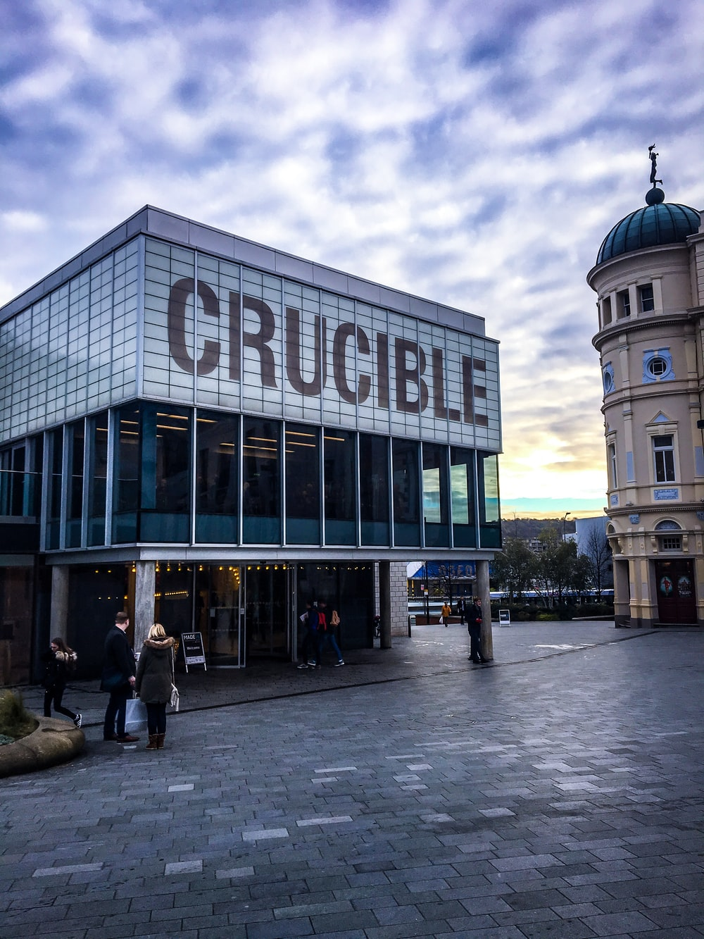 white and brown Crucible signage during daytime