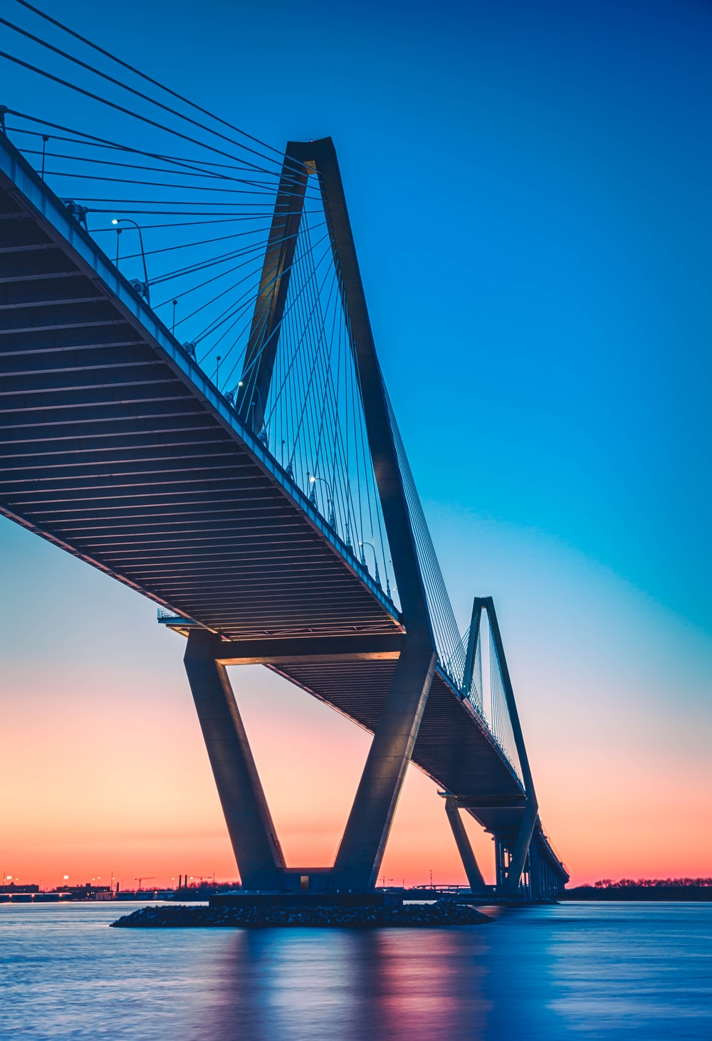 black bridge under blue sky during sunset