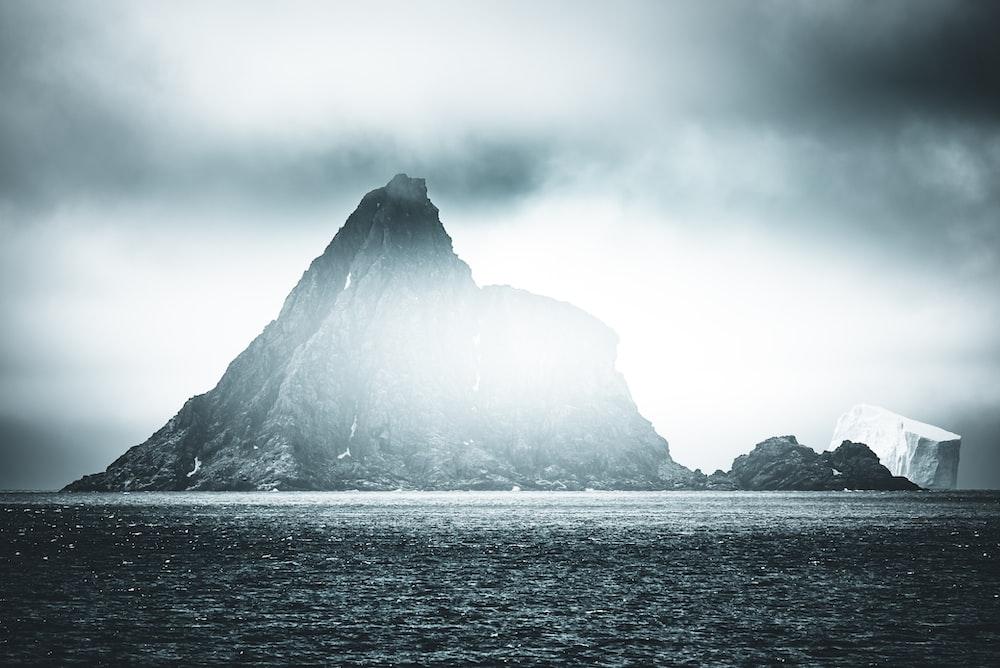 grayscale photography of island