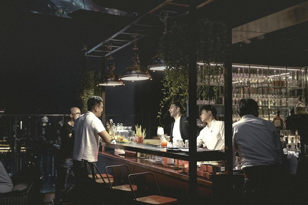 men sitting on bar stools