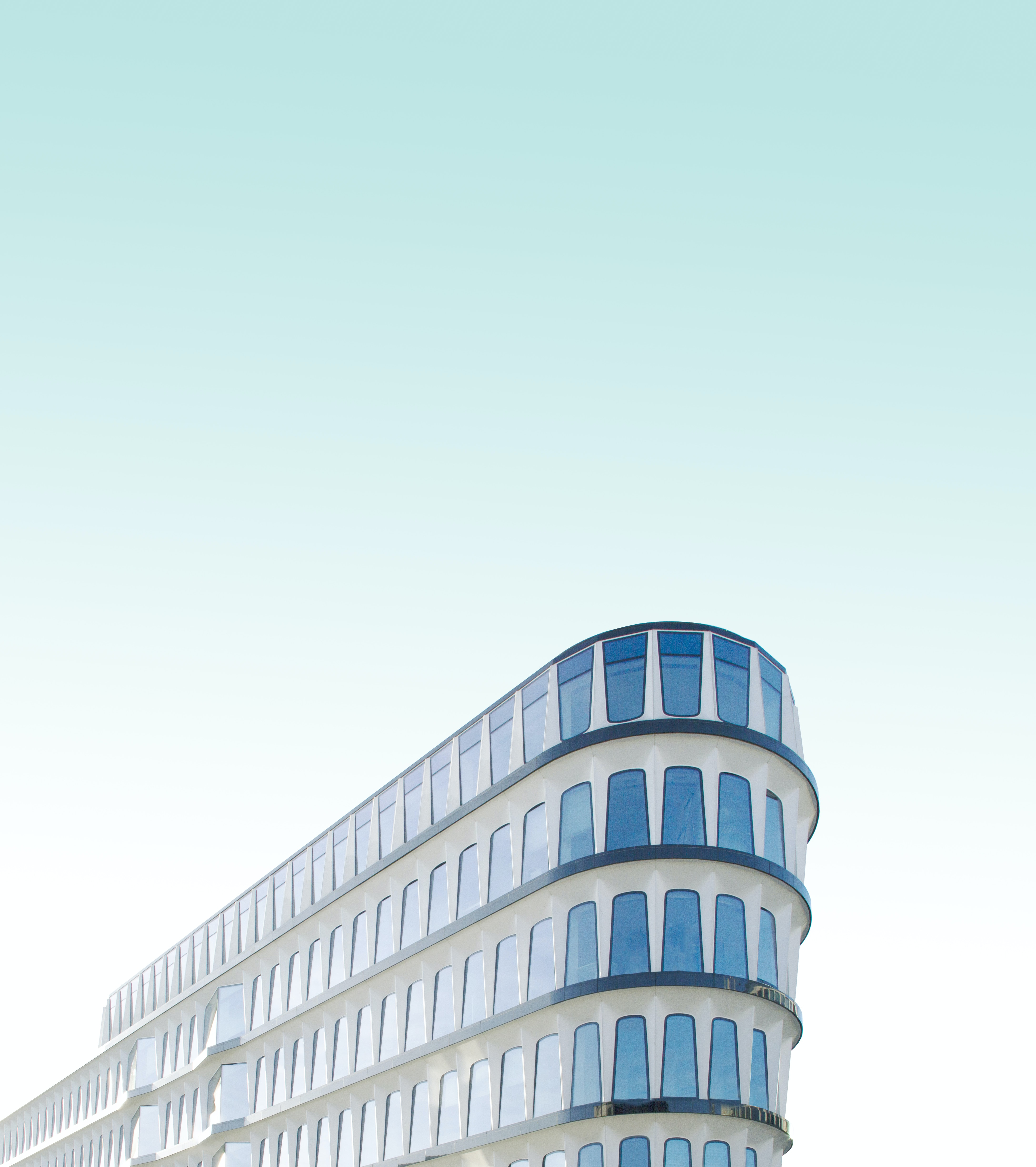 white and blue concrete building during daytime