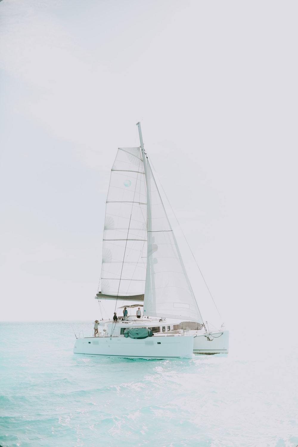 white yacht on body of water during daytime