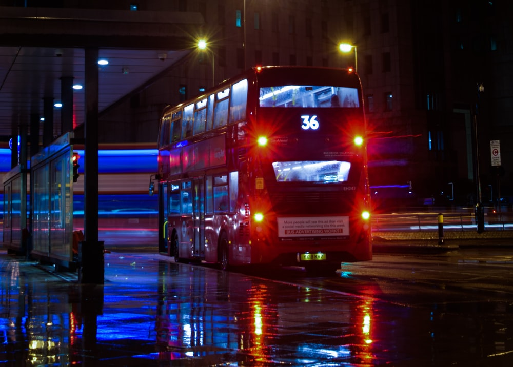 black double bus on road