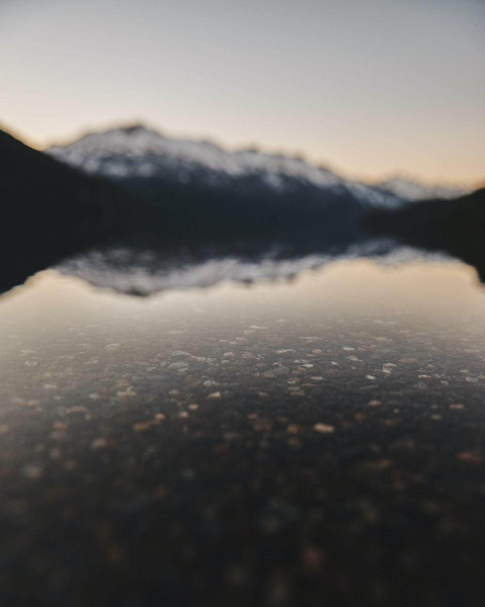 panoramic photography of mountain reflecting on water