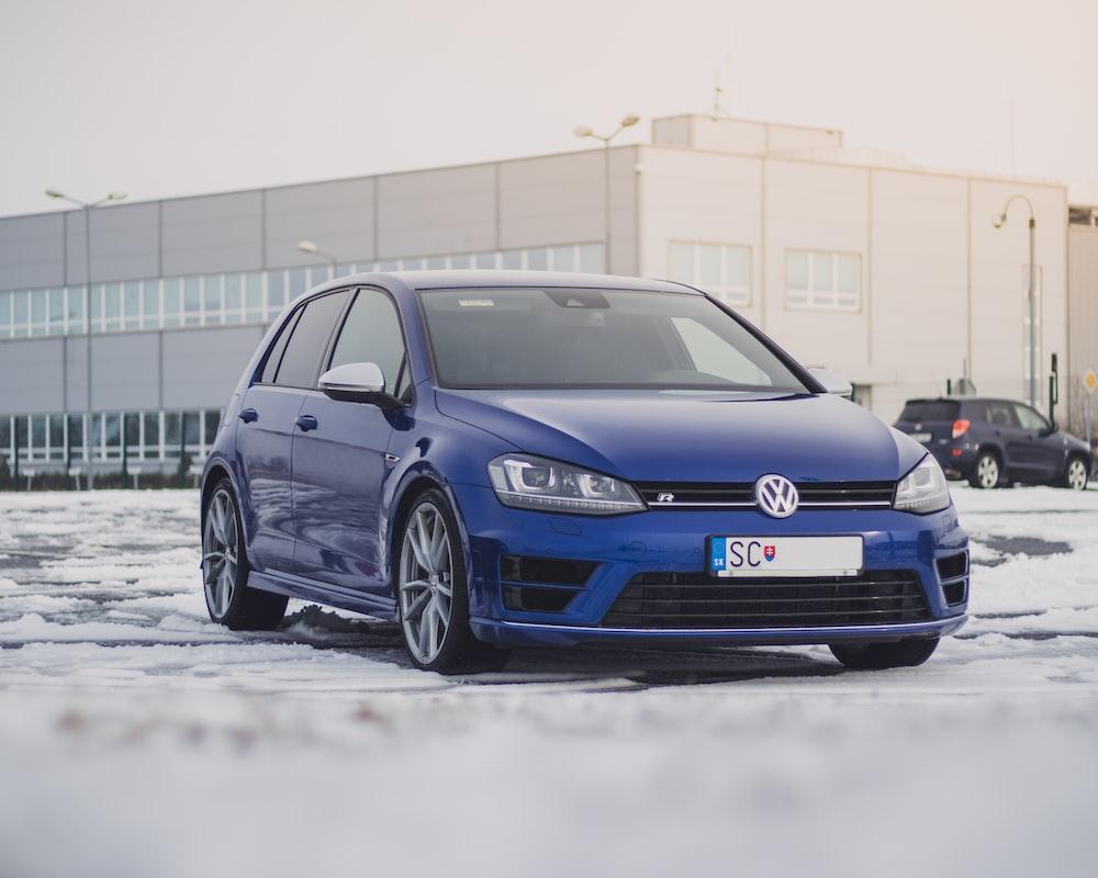 blue Volkswagen 5-door hatchback