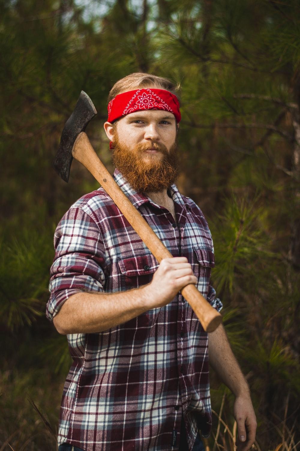 man carrying double-head axe