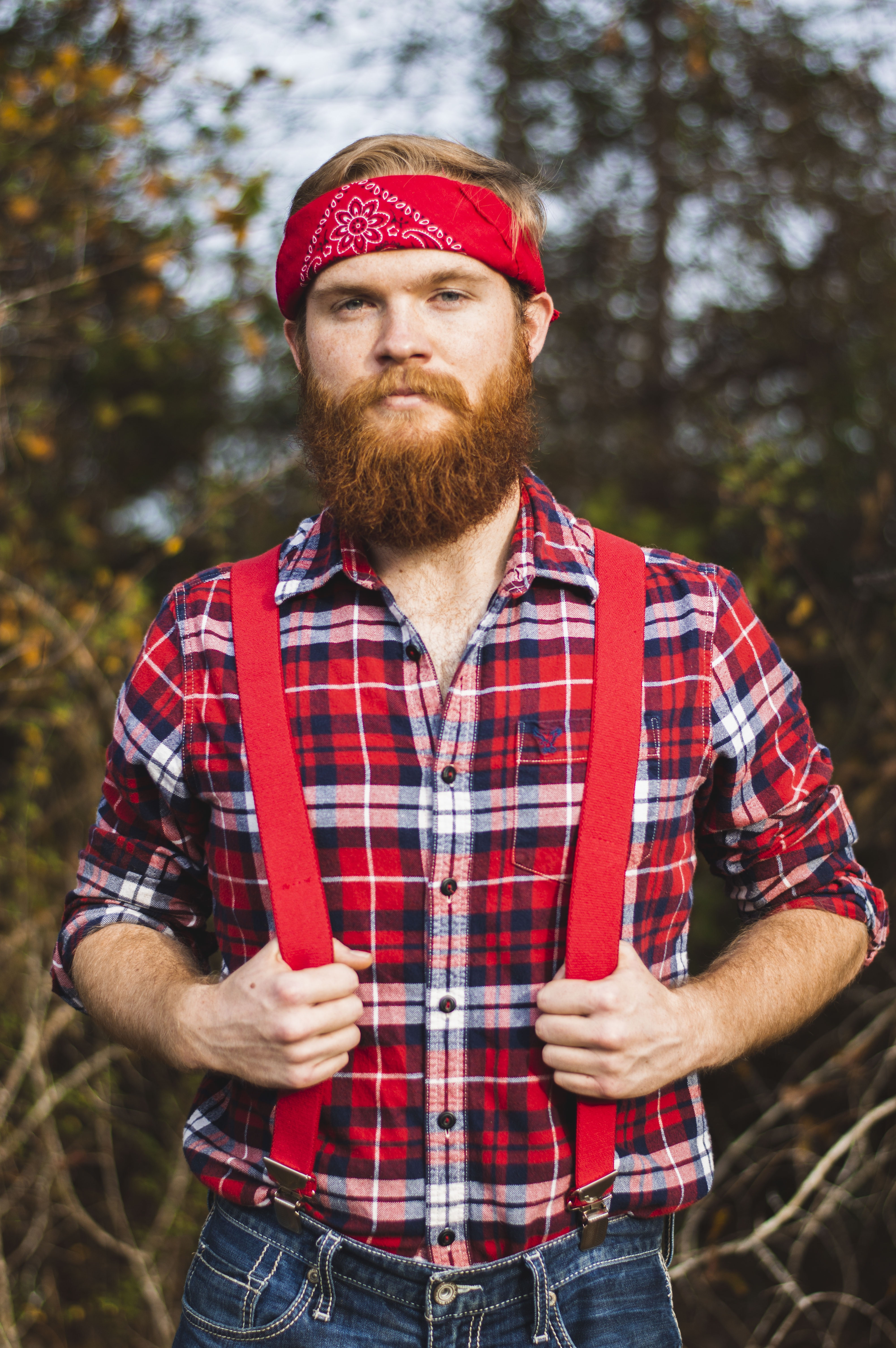 standing man wearing red and white floral kerchief close-up photo