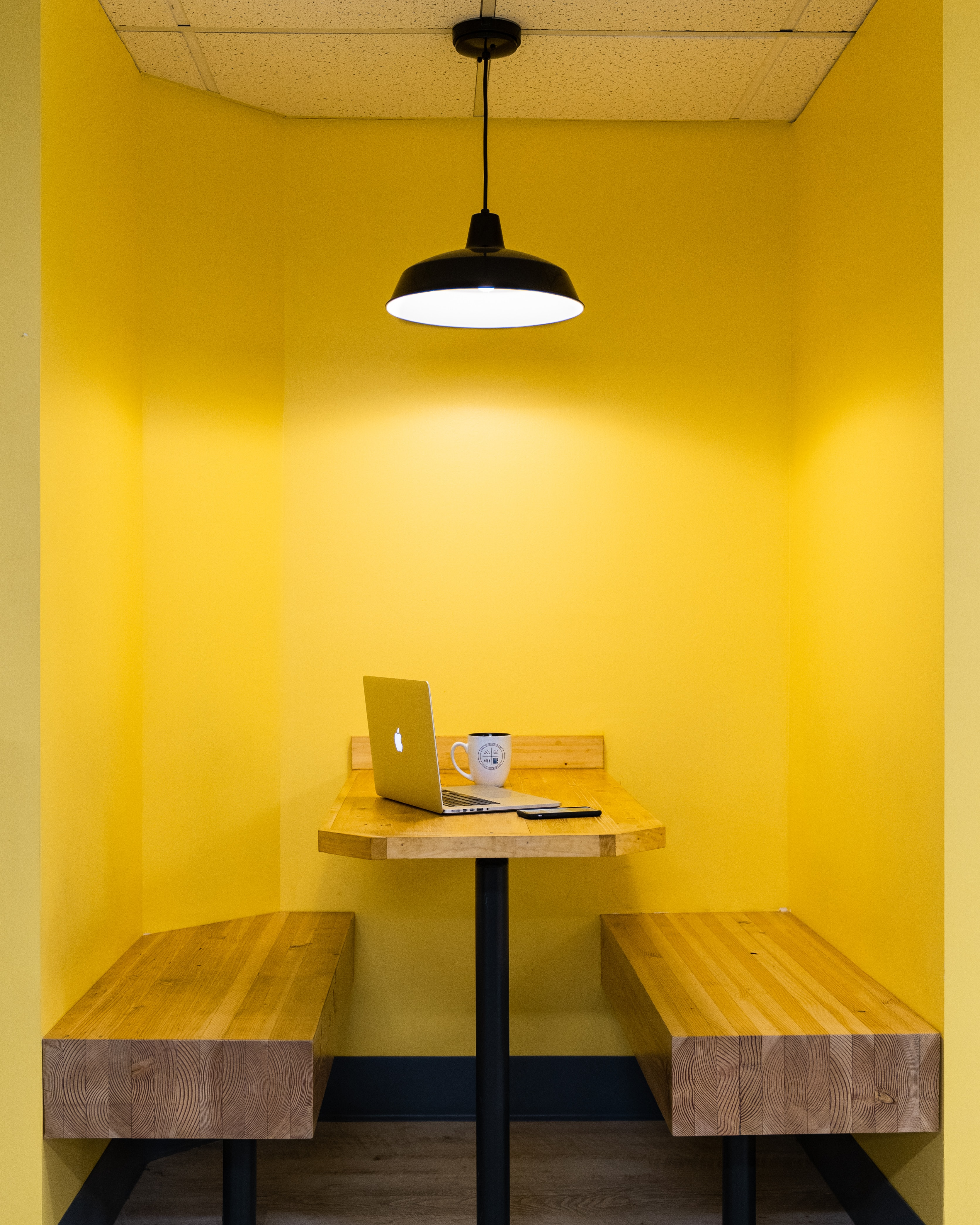 turned on pendant lamp on brown wooden table