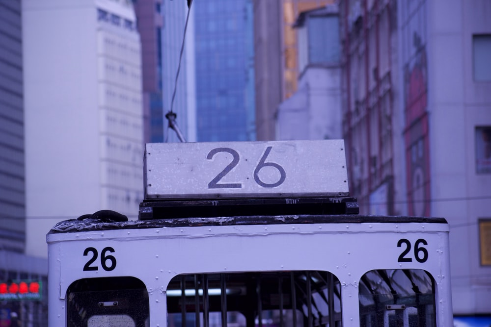 white cable car with 26 number on focus photography