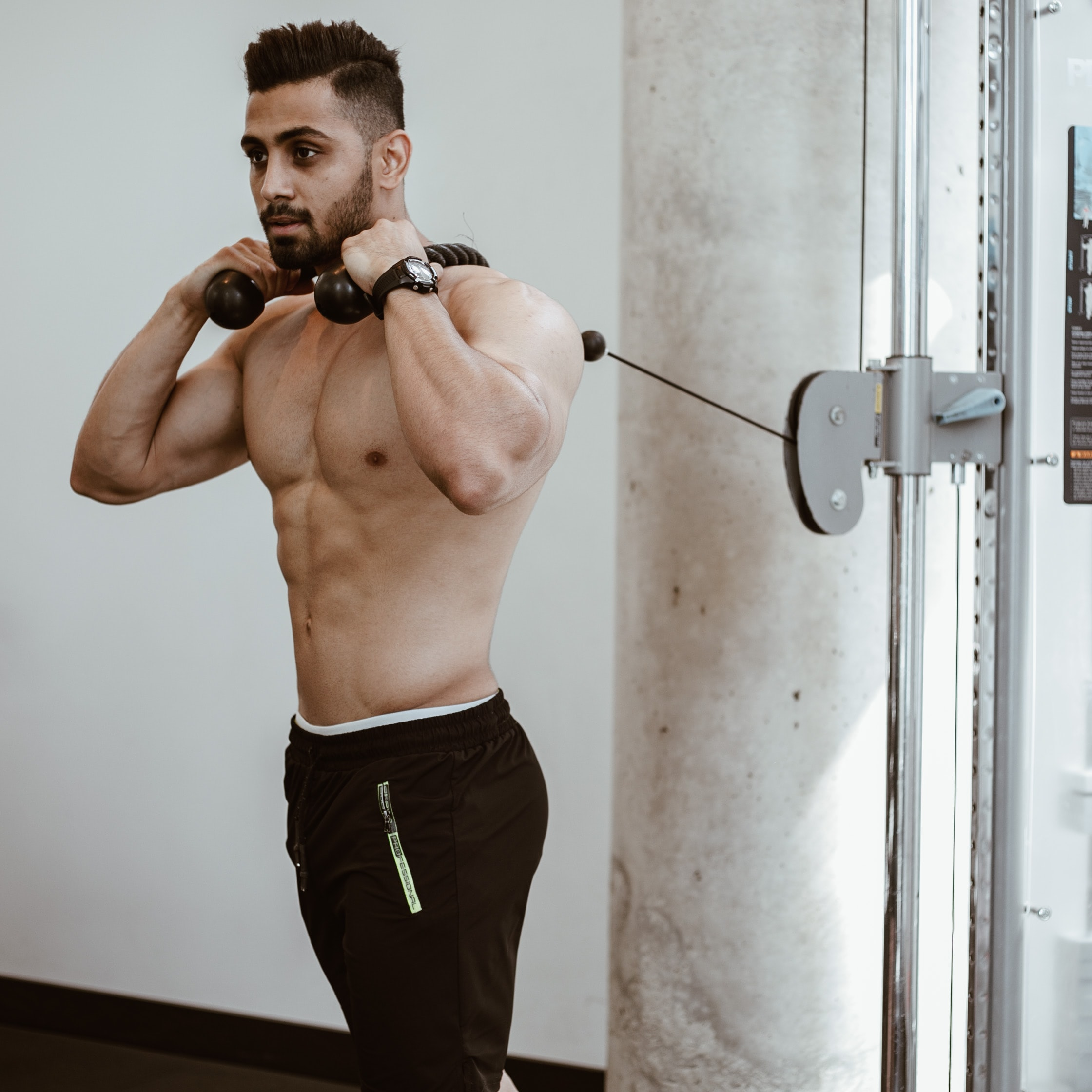 man wearing brown pants doing exercise