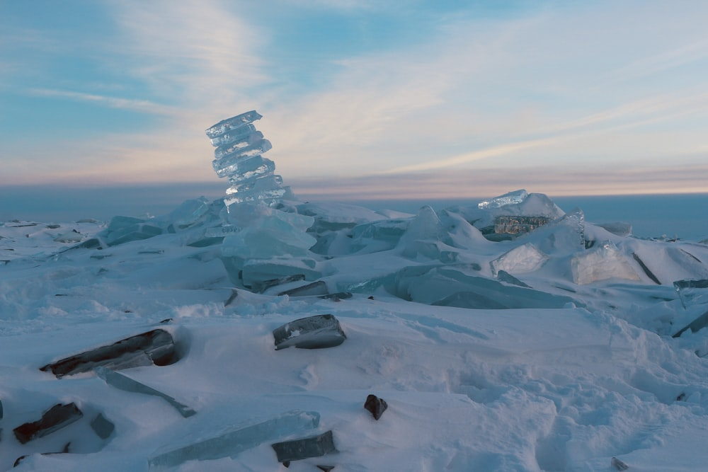 ice formation on snow field under white sky