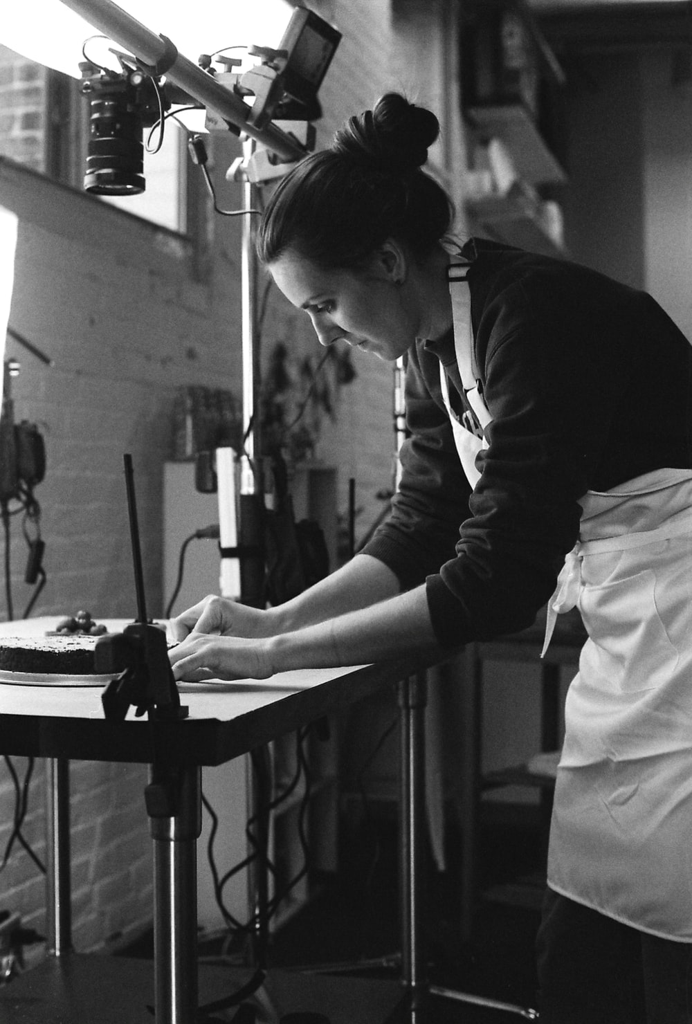grayscale photography of woman wearing apron