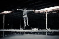 man jumping inside building