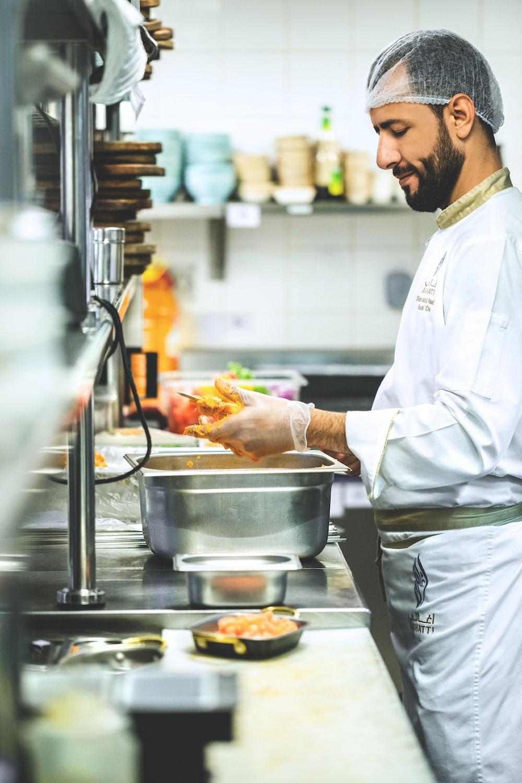 man slicing foods