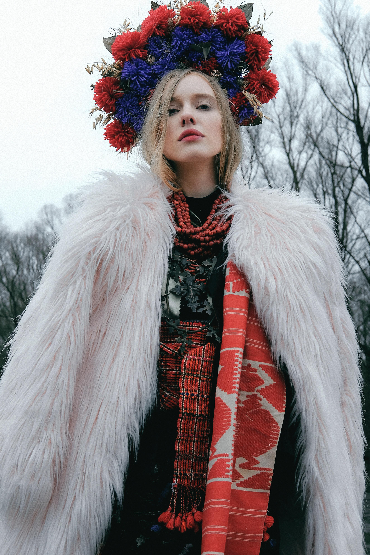 woman wearing white fur-line coat