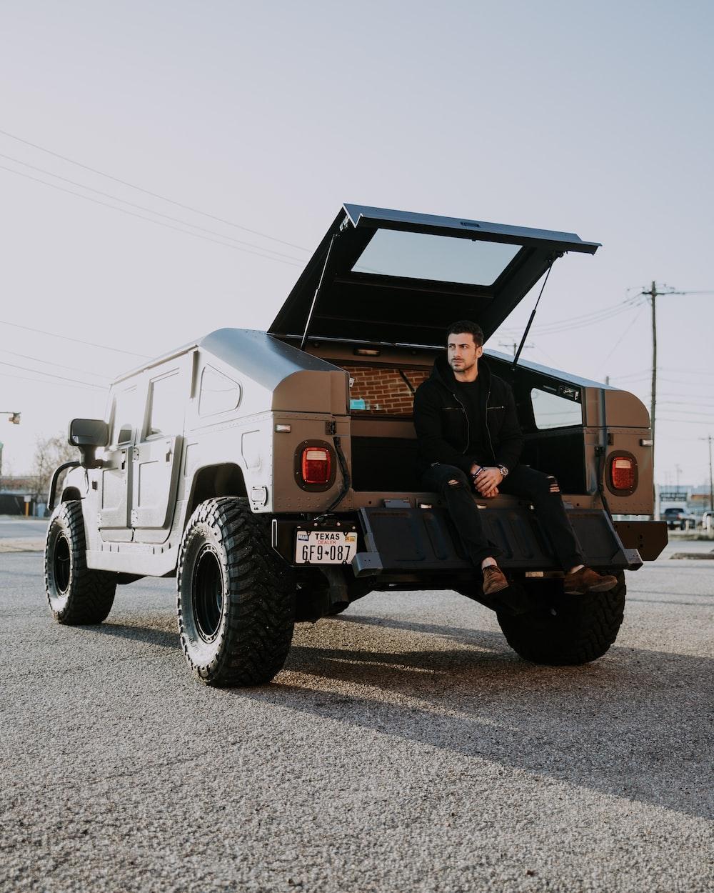 man sitting on vehicle