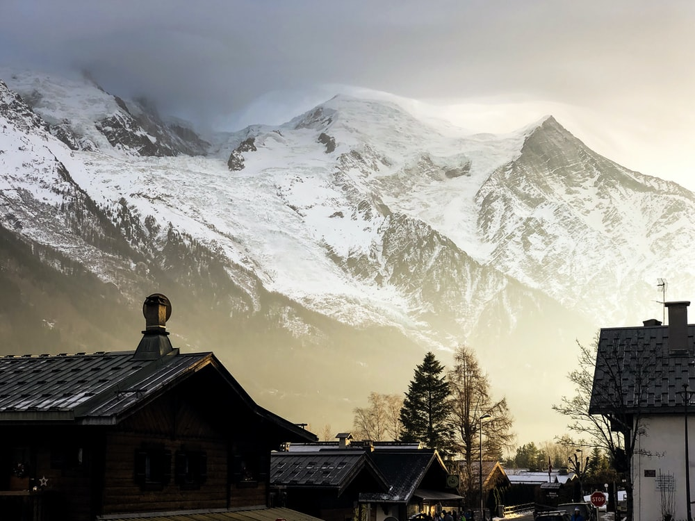 houses facing snow-covered mountains