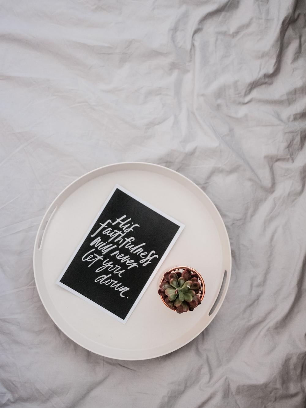 empty round white plate on white textile