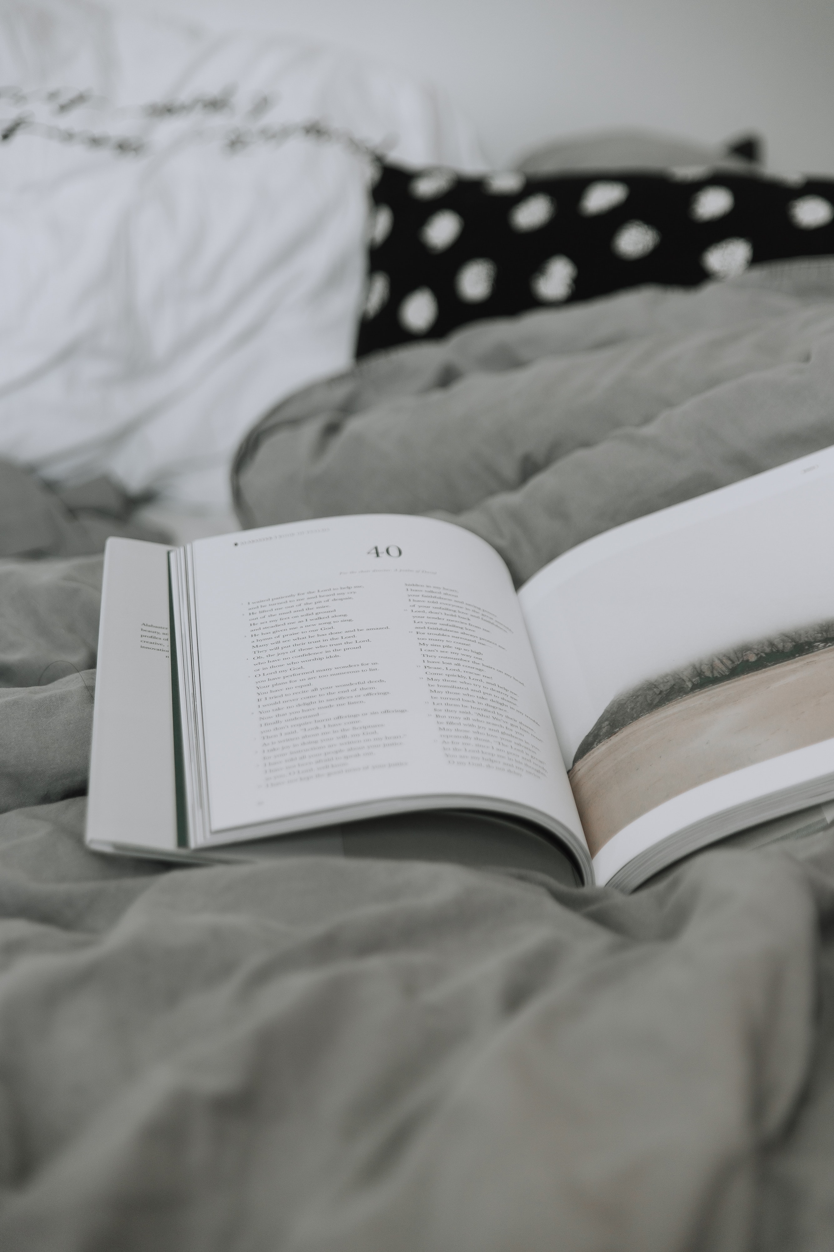 opened book on gray textile