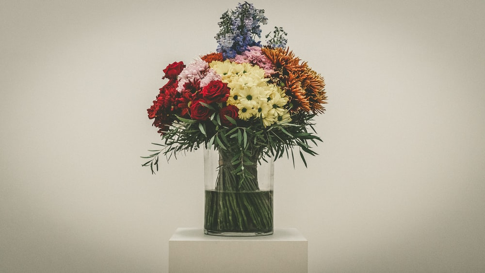 bouquet of red roses, yellow chrysanthemum and baby's breath flowers in vase