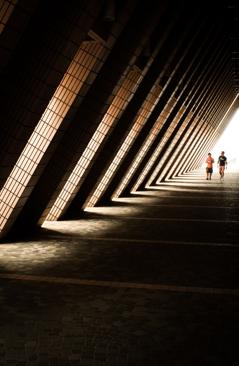 two person standing under arch