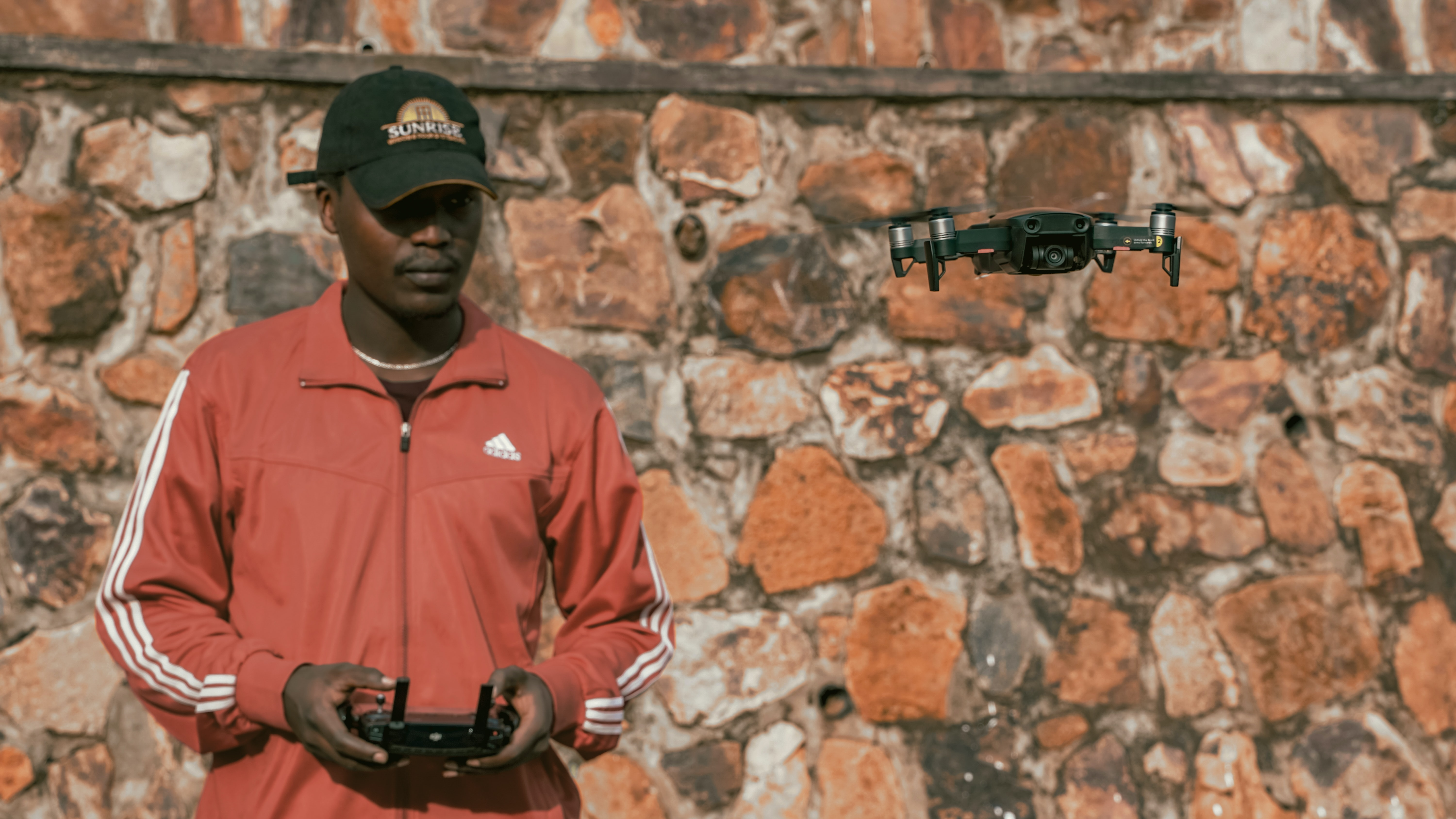 man controlling drone during daytime