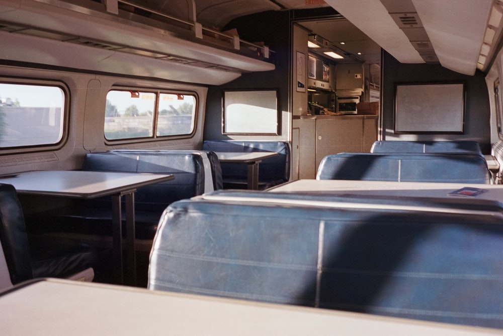 blue and white train seat with no people inside