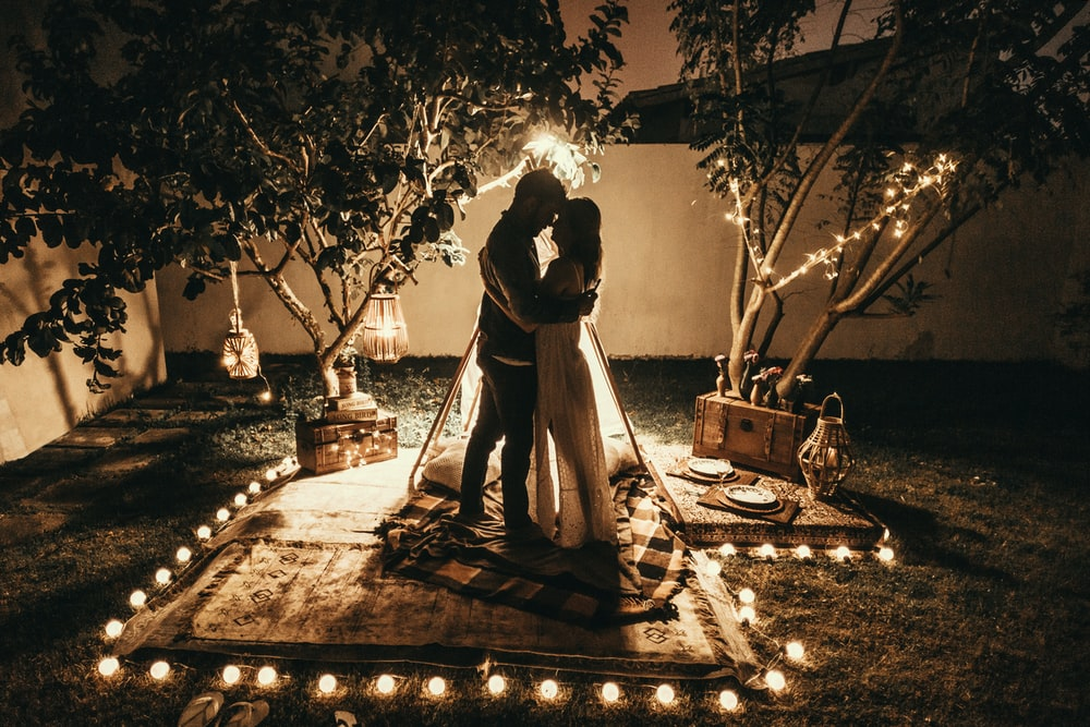 man and woman surrounded by tealights