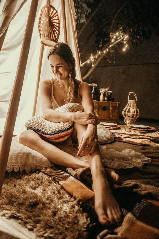 woman sitting near tent