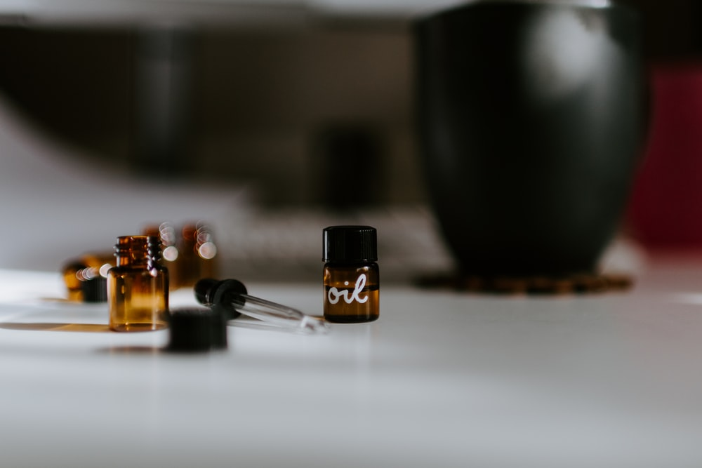 selective focus photography of brown oil bottles