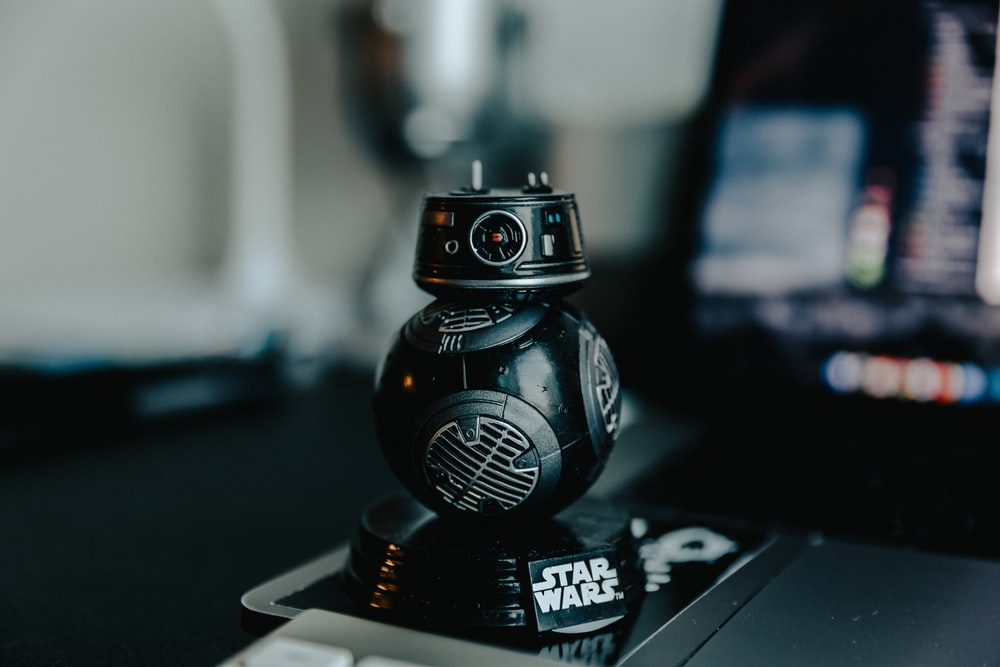selective focus photography of black Star Wars droid ornament