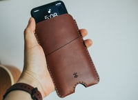 black smartphone in leather case