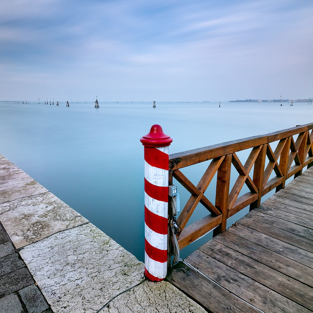 red and white pole near dock